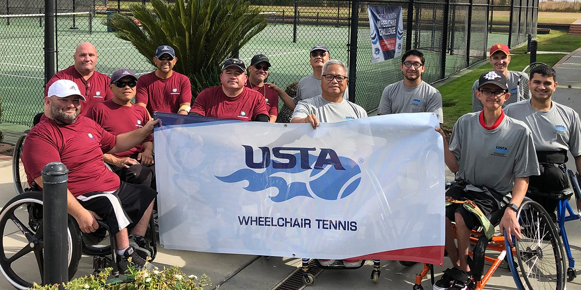 The teams from NorCal and SoCal hold the USTA Wheelchair Tennis banner up with pride.