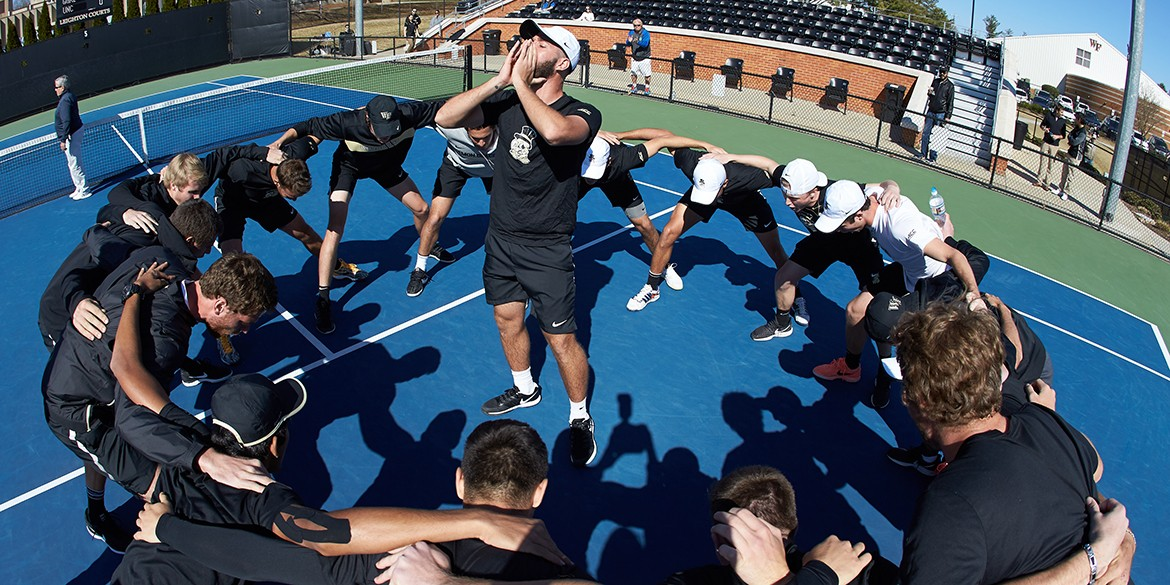 Petros Chrysochos of the Wake Forest Demon Deacons gets his team fired up prior to the start of the match against the North Carolina Tar Heels at the Wake Forest Tennis Center on March 27, 2019 in Winston-Salem, North Carolina. The Demon Deacons defeated the Tar Heels 5-2. (Brian Westerholt/Sports On Film)